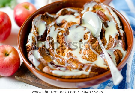 CARAMEL APPLE STRATA in a pig-iron frying pan. Stock photo © zoryanchik