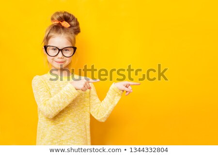 Young little girl pointing finger stock photo © lovleah