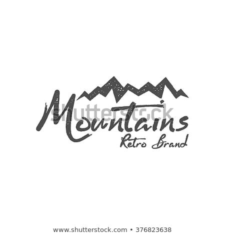 hand drawn mountain badge wilderness old style typography mountain label retro mountain logo desig stock photo © jeksongraphics