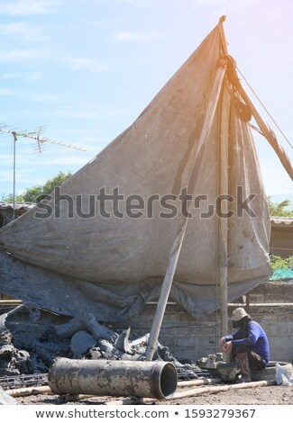 Man digging the ground with core drill Stock photo © bluering