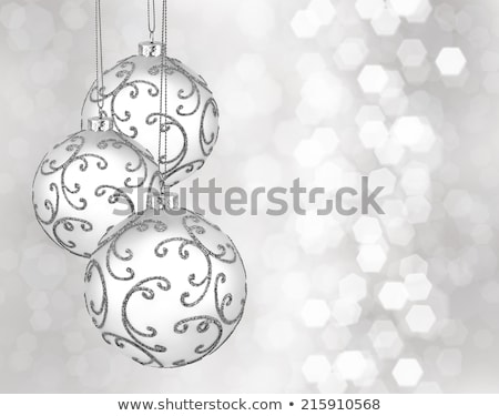 three christmas ball on silver bokeh background Stock photo © SArts