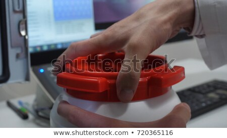 Chemical scientist opening white unlabeled plastic tank canister Stock photo © stevanovicigor