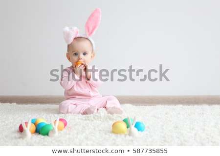 Baby girl sitting on floor with plaid Stock photo © deandrobot