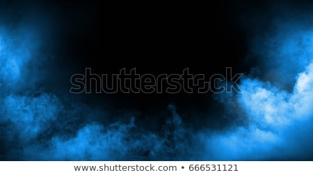 Dark interior full of dense, white fume Stock photo © konradbak