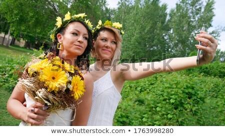 bride taking selfie with her friend stock photo © wavebreak_media