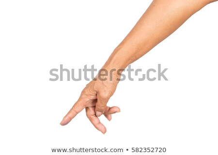 elderly woman pointing finger up isolated on white background stock photo © studiostoks
