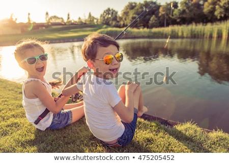 Ragazzi pesca stagno natura bambino giovani Foto d'archivio © IS2