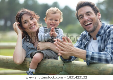 Girl and boy on gate in countryside Stock photo © IS2