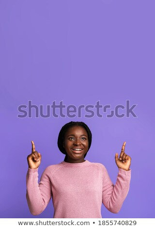 Vertical image of two cheerful women posing in studio stock photo © deandrobot
