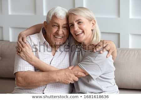senior couple man woman sit together stock photo © is2