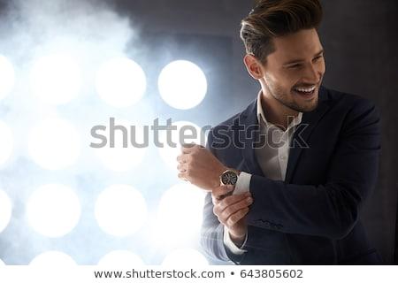Junger Mann Smoking stehen ein Hand Tasche Stock foto © feedough