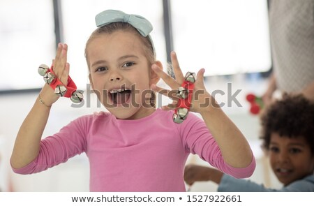 little african girl playing the tambourine stock photo © rastudio