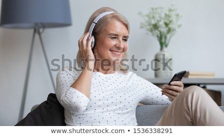 Women smiling at mp3 player Stock photo © IS2