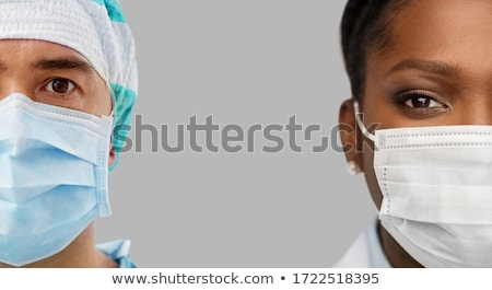 Half face portrait of female medical professional with surgical  Stock photo © stevanovicigor