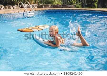 mulher · jovem · natação · subaquático · piscina · mergulho - foto stock © is2