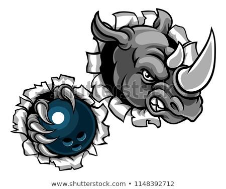 rhino holding bowling ball stock photo © krisdog