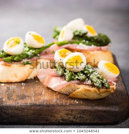Fresh sendwich with ham, asparagus and quail eggs Stock photo © Melnyk