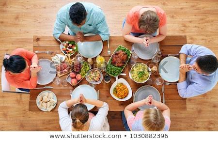 Stok fotoğraf: Grup · insanlar · tablo · dua · eden · yemek · kahvaltı · aile