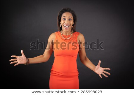 Shocked african woman in dress looking at the camera Stock photo © deandrobot