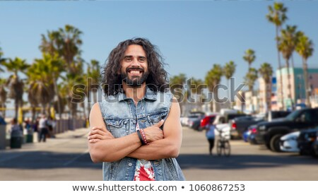 hippie man in demin vest at venice beach in la Stock photo © dolgachov