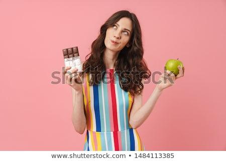 Faim jeune femme isolé rose mur Photo stock © deandrobot