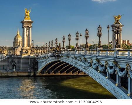 Golden statues on Alexandre III bridge Stock photo © vapi