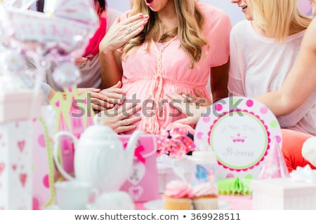 Best Friends on baby shower party celebrating giving kid stuff as present Stock photo © Lopolo