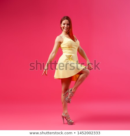 Fashion Model girl isolated over pink background. Beauty stylish woman posing in fashionable clothes Stock photo © studiolucky