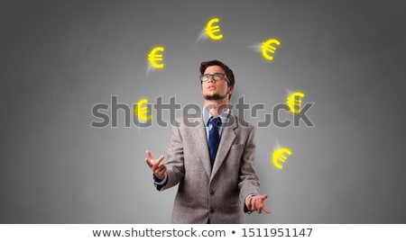 Person juggle with euro symbol Stock photo © ra2studio