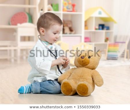 играет · фаршированный · животного · девочку · мишка - Сток-фото © lopolo