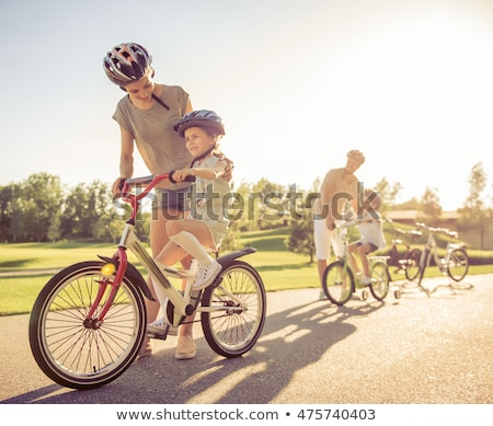 People in Park Girl Riding Bike, Mother Daughter Stock photo © robuart