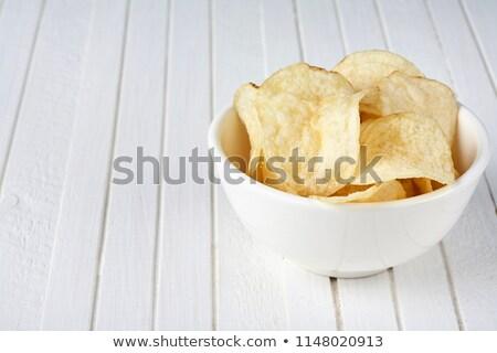 Cam çanak plaka patates cips sarımsak Stok fotoğraf © DenisMArt