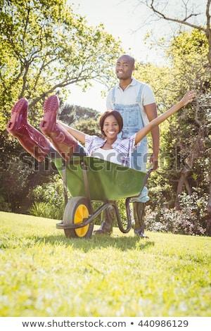 paar · man · vrouw · kruiwagen · glimlach · gelukkig - stockfoto © monkey_business