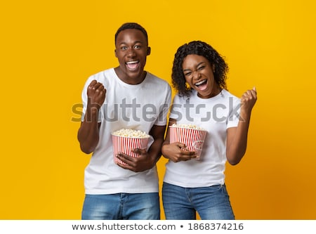 Young excited friends or dates with snack cheering for their football team Stock photo © pressmaster