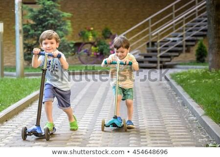 少年 · ライディング · 屋外 · 公園 · 夏場 - ストックフォト © galitskaya