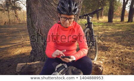 Cycling Woman with Backpack on Back Springtime Stock photo © robuart