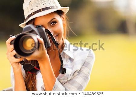 Csinos női fotós digitális fényképezőgép dslr hatalmas Stock fotó © lightpoet