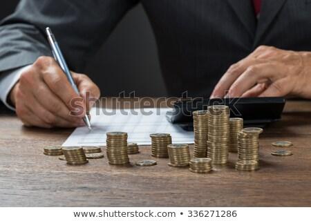 Businessman Checking Invoice Stock photo © AndreyPopov