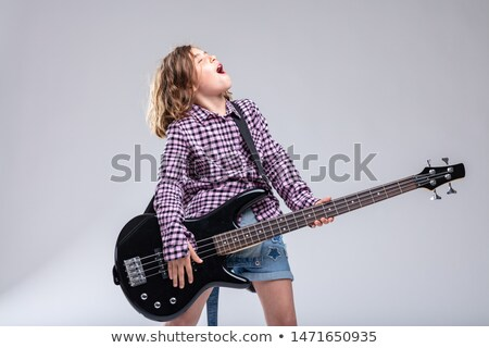 Tehetséges fiatal lány gitáros énekel játszik elektromos gitár Stock fotó © Giulio_Fornasar
