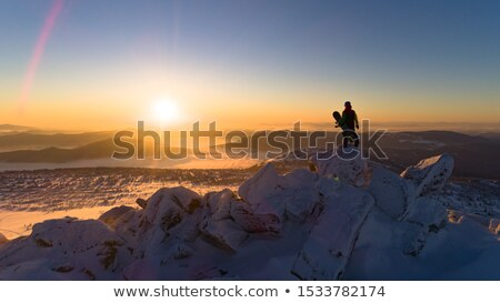Family of snowboarders on top of the mountain. Stock photo © ConceptCafe