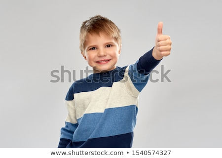 smiling boy in striped pullover showing thumbs up Stock photo © dolgachov