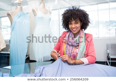 Front view of young Mixed-race female fashion designer working in design studio  Stock photo © wavebreak_media