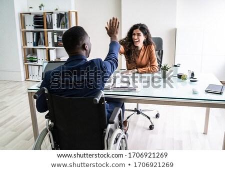 Niepełnosprawnych biznesmen high five partnerem uśmiechnięty kobiet Zdjęcia stock © AndreyPopov