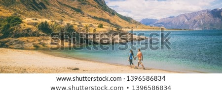 Panoramic banner of Couple walking on beach in New Zealand - people in Ship Creek on West Coast of N Stock photo © Maridav