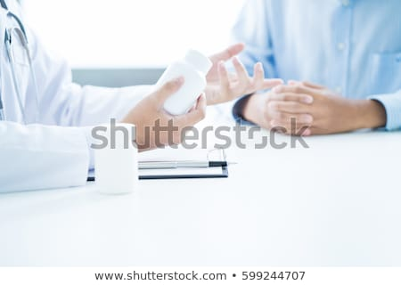 Close-up of a doctor giving a pill Stock photo © ra2studio