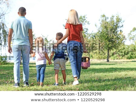 family with picnic basket walking in summer park Stock photo © dolgachov