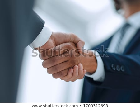 Empresário mãos negócio homem azul Foto stock © luckyraccoon