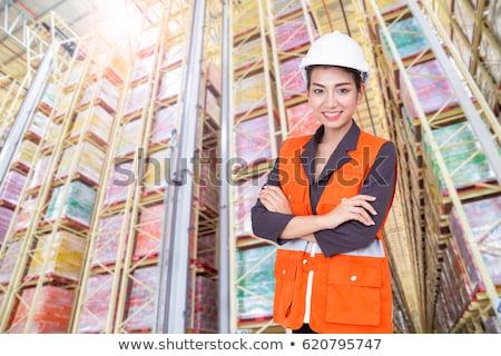 üzletember · áll · keresztbe · tett · kar · raktár · középső · rész · üzlet - stock fotó © wavebreak_media