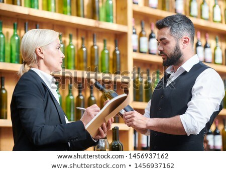 Two colleagues discussing new sort of wine in cellar Stock photo © pressmaster