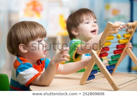 Garçon sur aire de jeux maternelle maison Photo stock © galitskaya